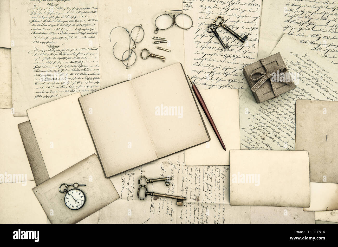 Vintage Office Accessories, Open Diary Book And Old Handwritten Letters.  Nostalgic Paper Background