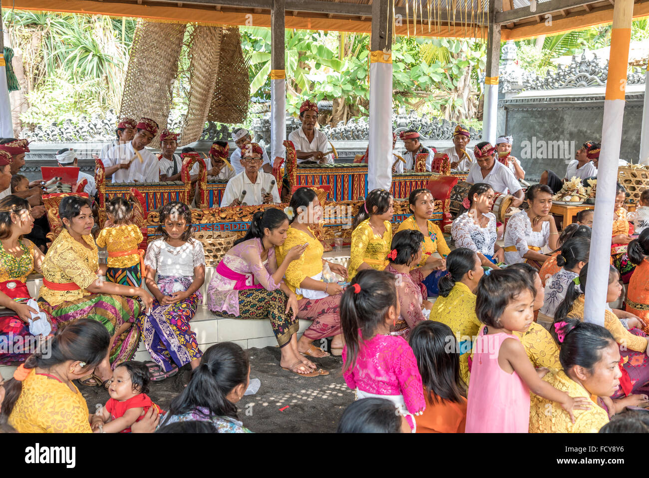 traditional gamelan ensemble and audience  during a temple ceremony in Lovina Bali, Indonesia - Stock Image