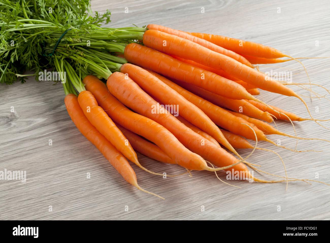 Fresh bunch of orange carrots - Stock Image