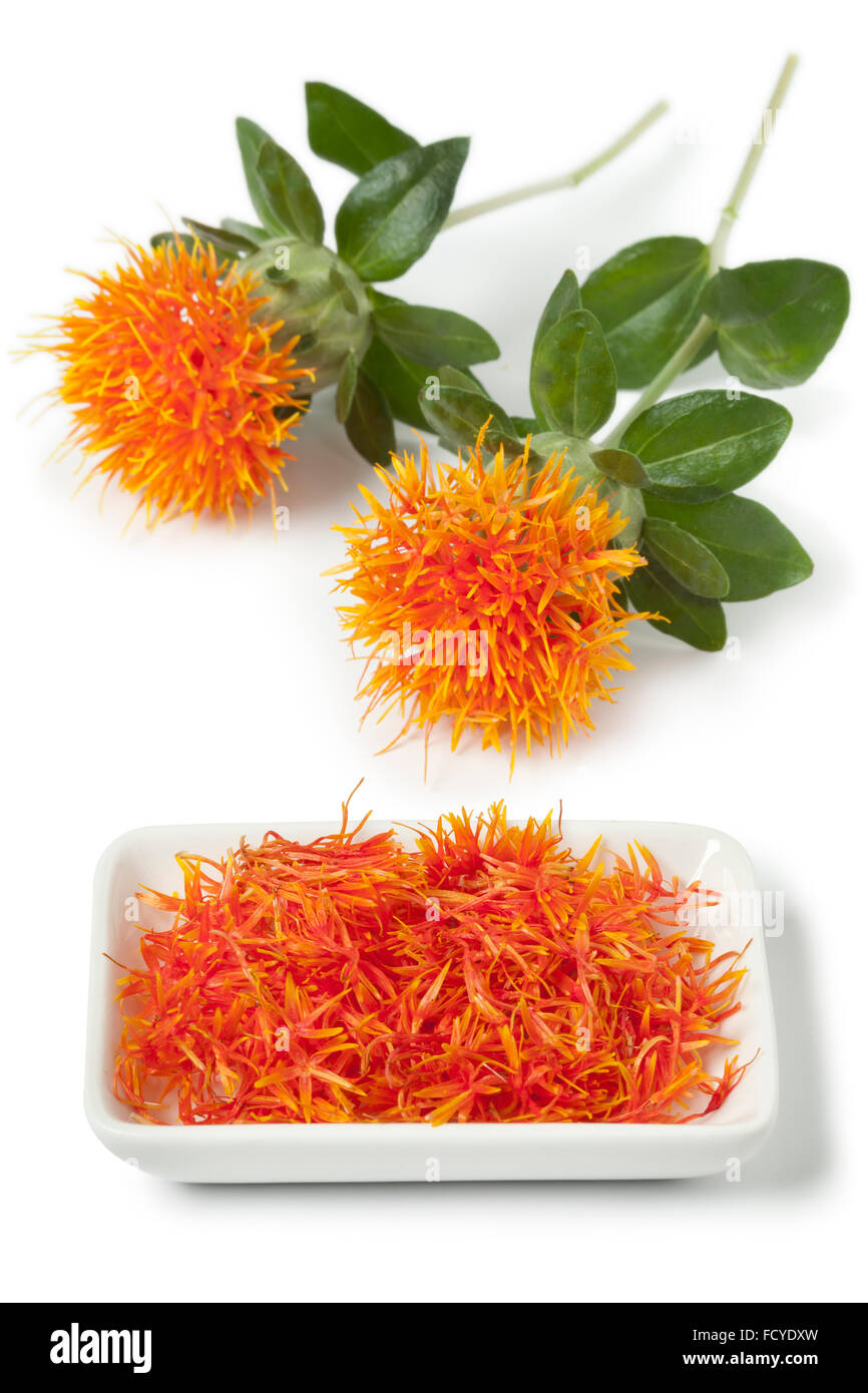 Dish with imitation Saffron from safflower on white background - Stock Image