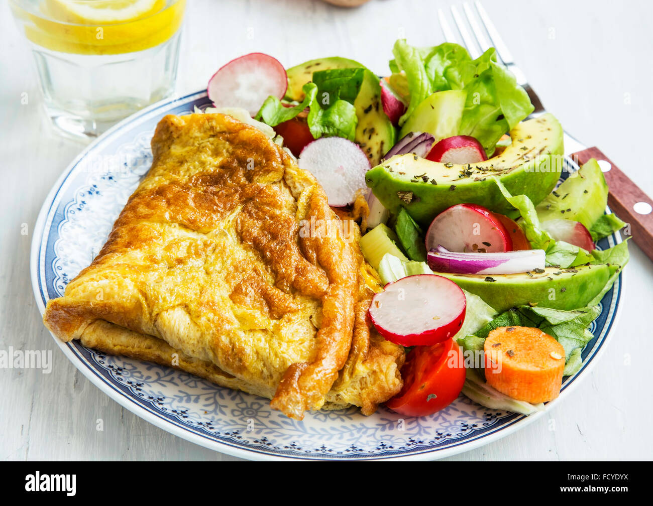 Omelette with vegetables salad and avocado,healthy breakfast meal - Stock Image