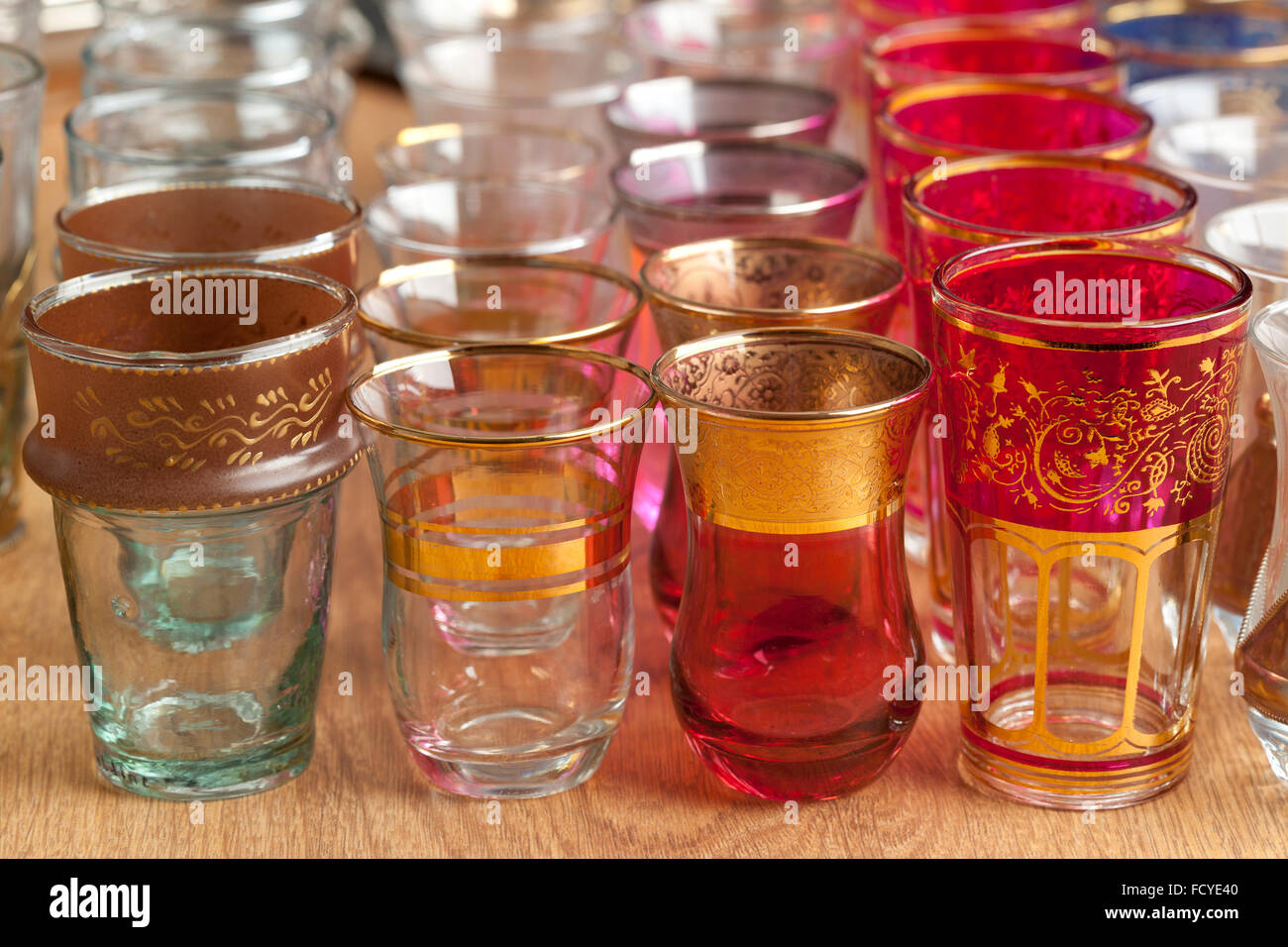 Traditional colorful Moroccan tea glasses on the market - Stock Image