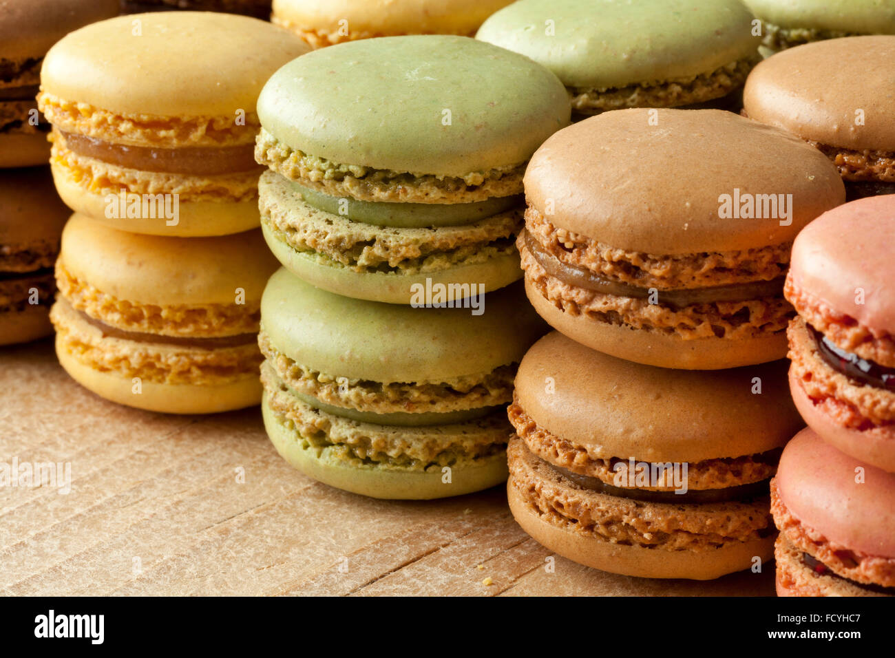 Fresh baked french macarons in rows - Stock Image