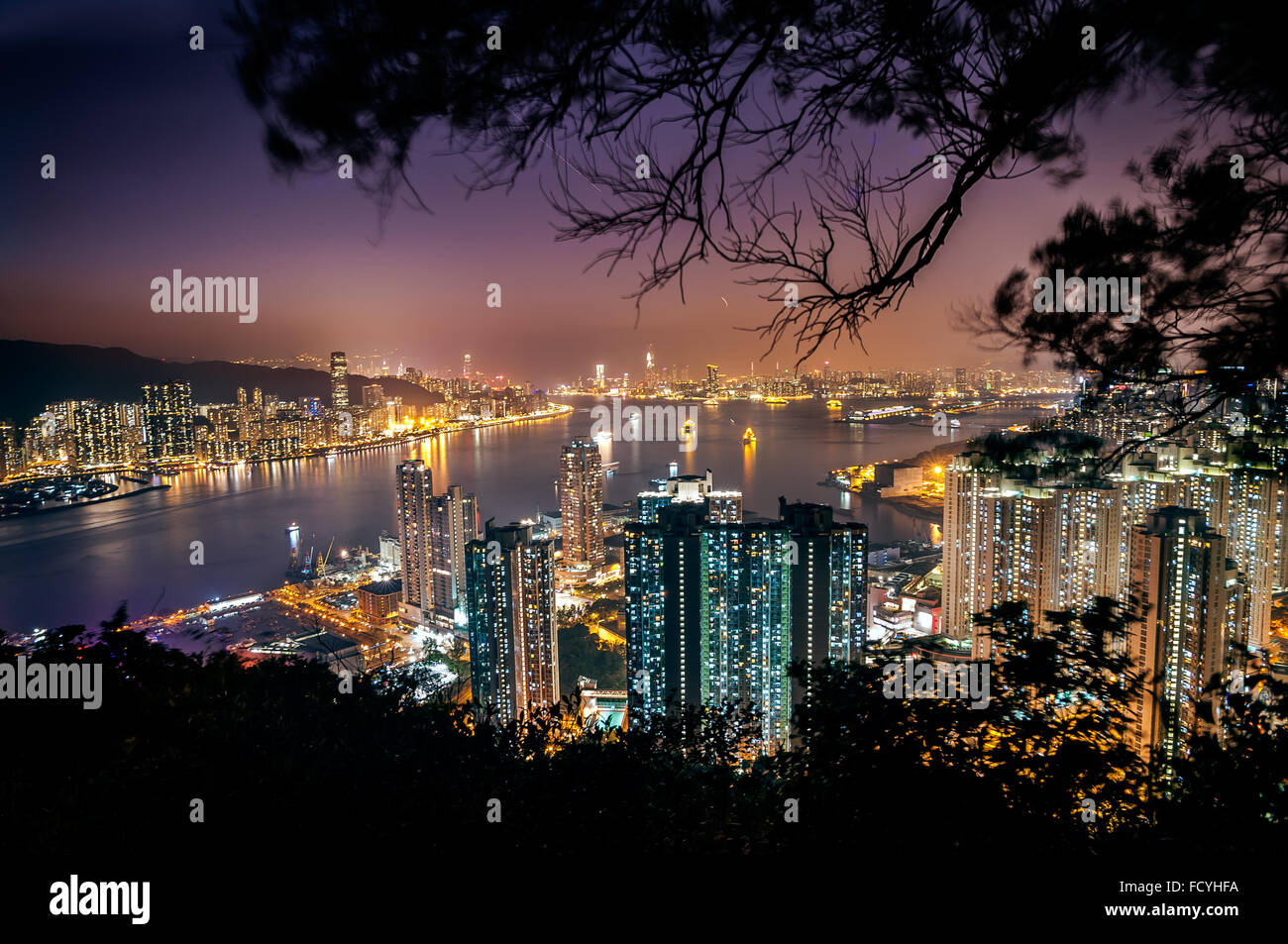 Illuminated cityscape and Victoria Harbour as seen from Devil's Peak, Kowloon - Stock Image