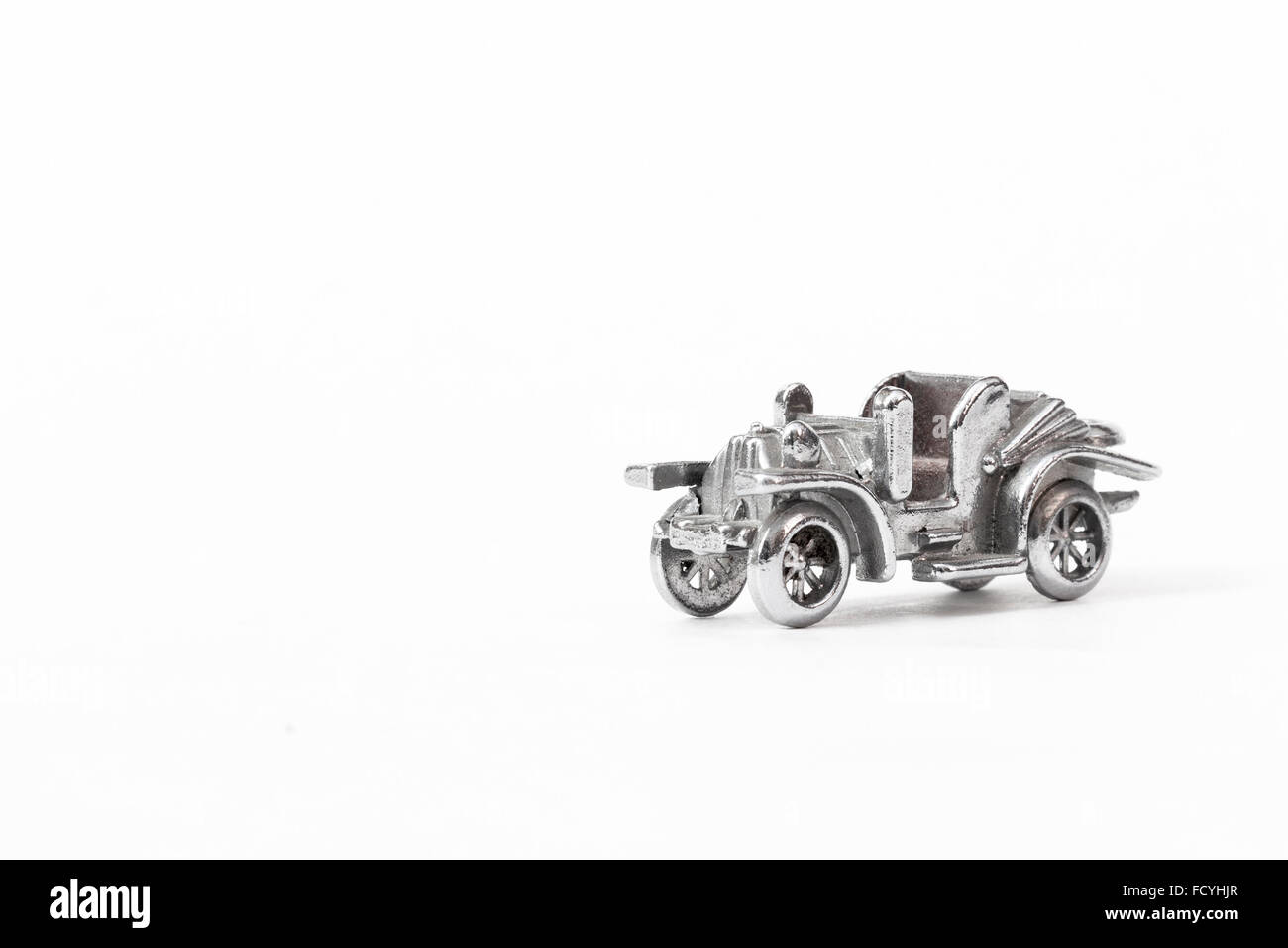 Metal model of the ancient car - Stock Image