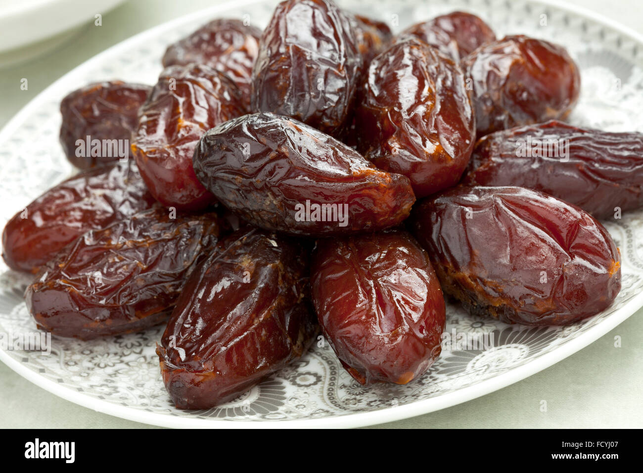Dish with preserved ripe Medjool dates for festive occasions - Stock Image