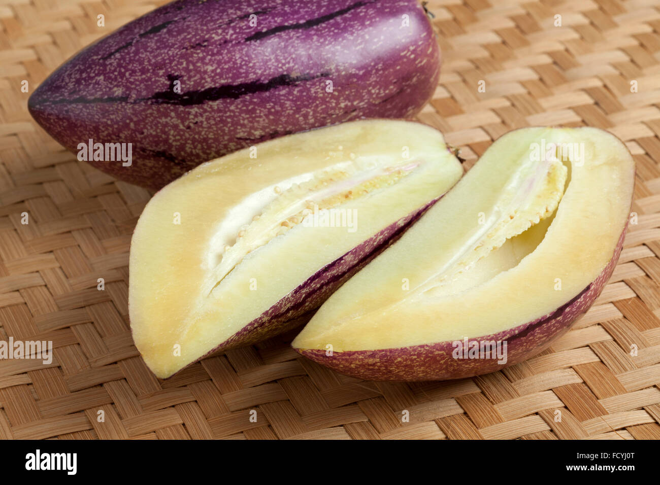 Fresh whole and partial pepino fruit - Stock Image