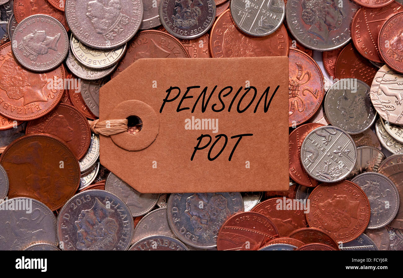 Pension pot label on British mixed coins - Stock Image