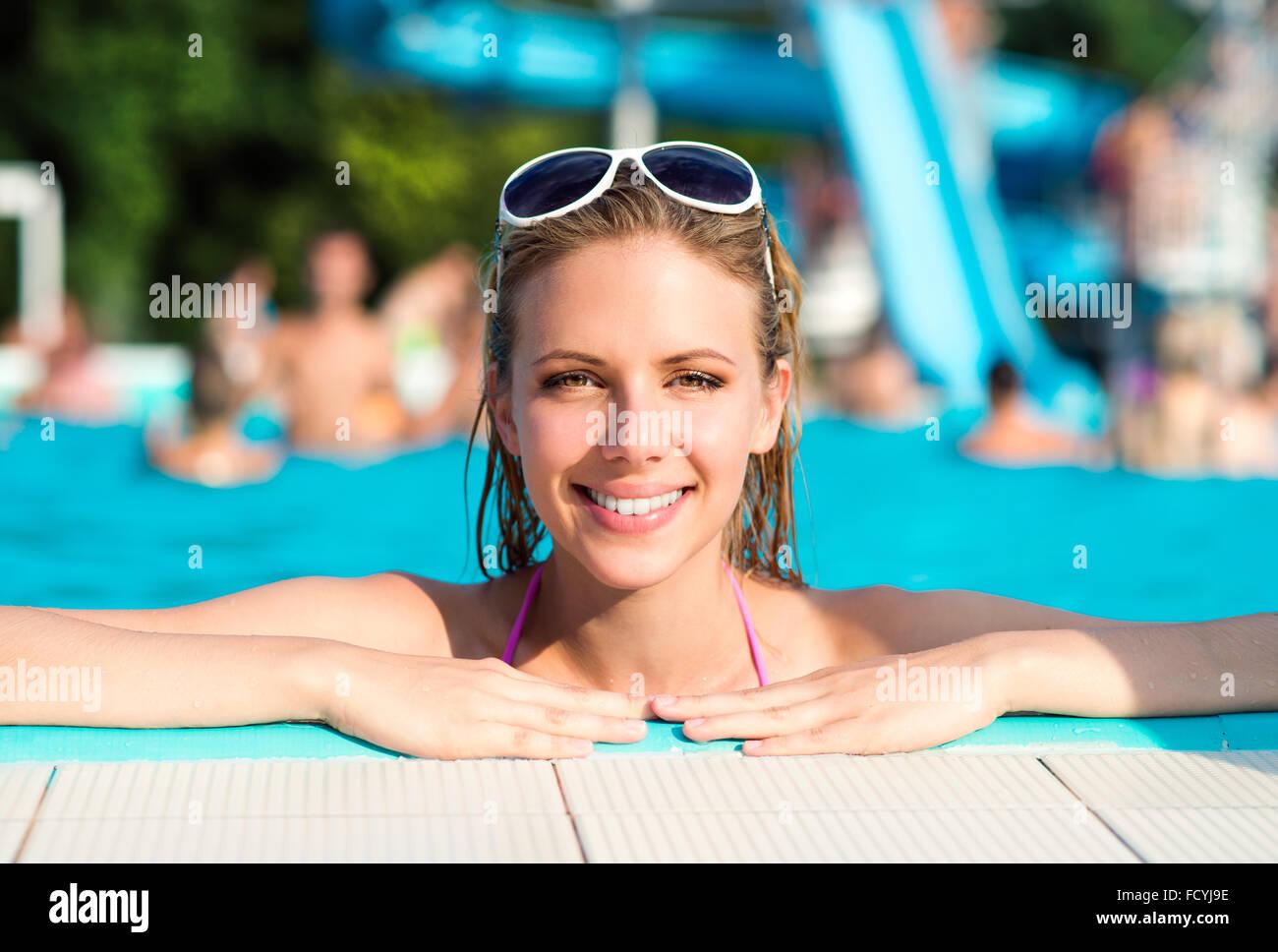 Beautiful young woman in the swimming pool Stock Photo