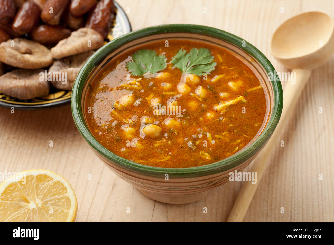 Bowl of Moroccan harira soup, lemon, dates and figs for iftar - Stock Image