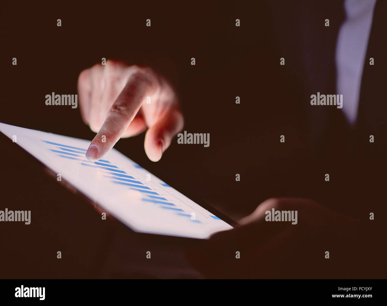 Businessman working with data in touchpad - Stock Image