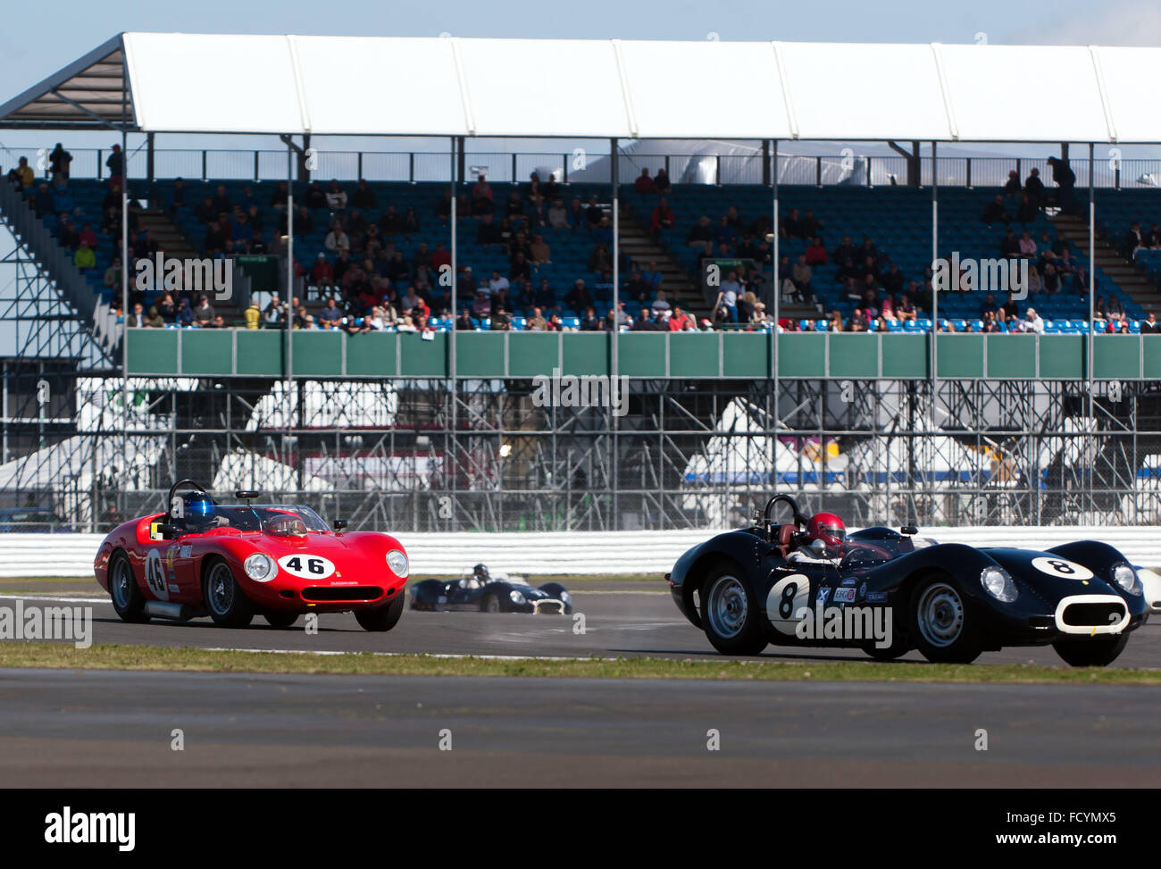 A Ferrari 246S and a Lister Knobbly, competing in the Stirling Moss Trophy for Pre' 61 Sports Cars at the Silverstone - Stock Image