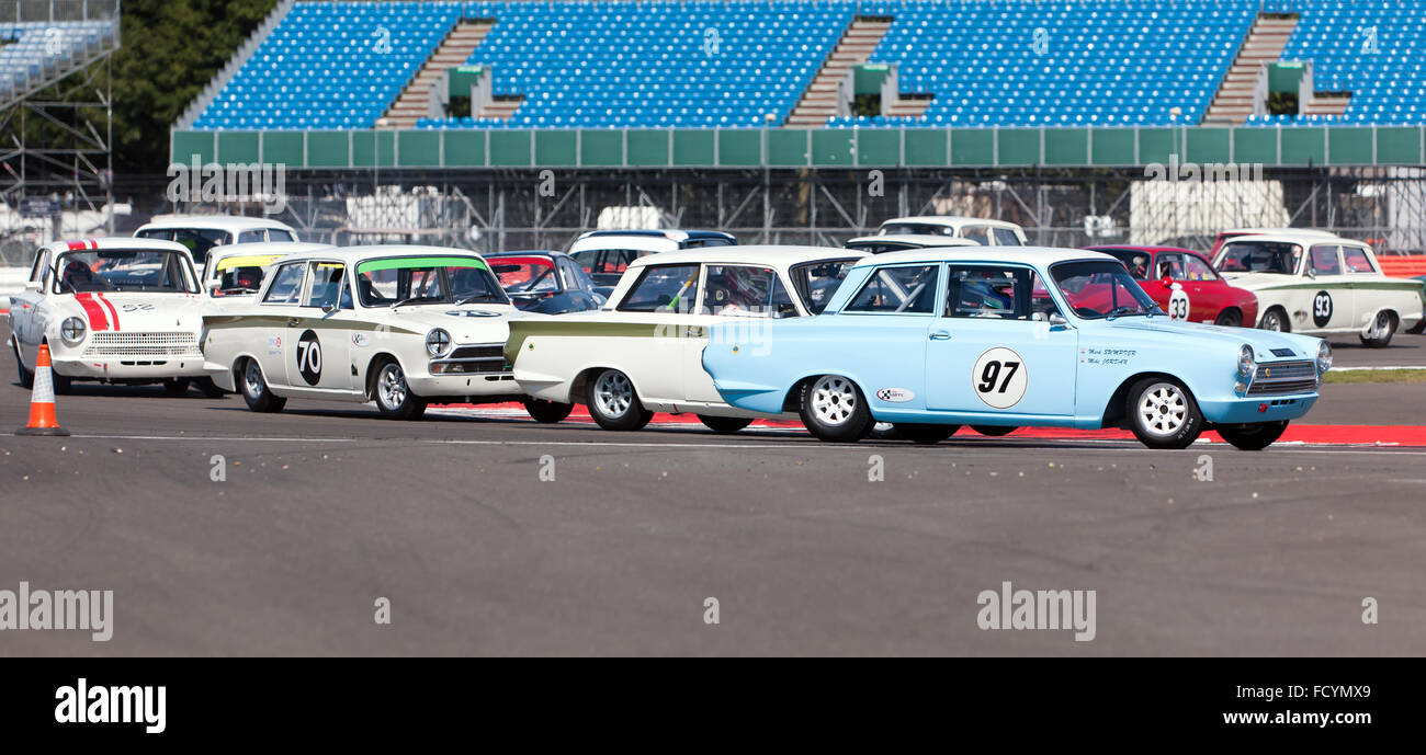 Close racing during the Warwick Banks Trophy for Under 2 litres Touring Cars, Silverstone Classic 2015. - Stock Image