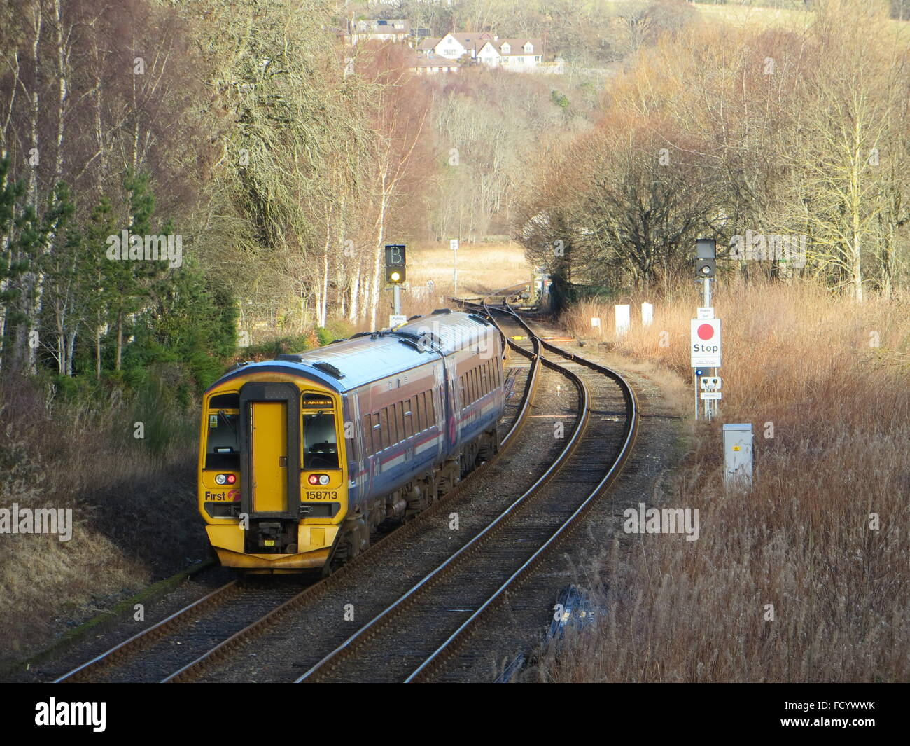 A Scot Rail train leaves Dingwall Station in the Scottish Highlands. - Stock Image