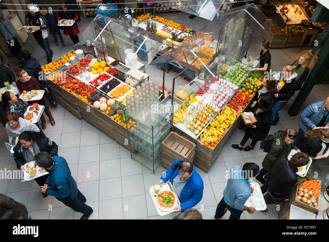 Customers serve themselves & queue to pay; La Place self-service food restaurant, Amsterdam city centre. Holland - Stock Image