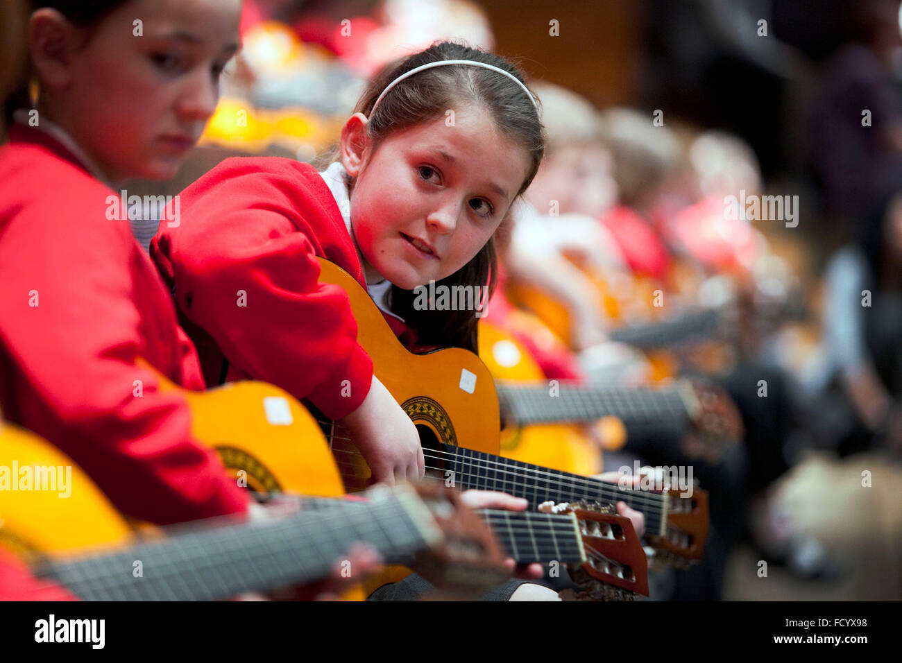 Primary school pupils take part in a guitar concert at the Bridgewater Hall , Manchester - Stock Image