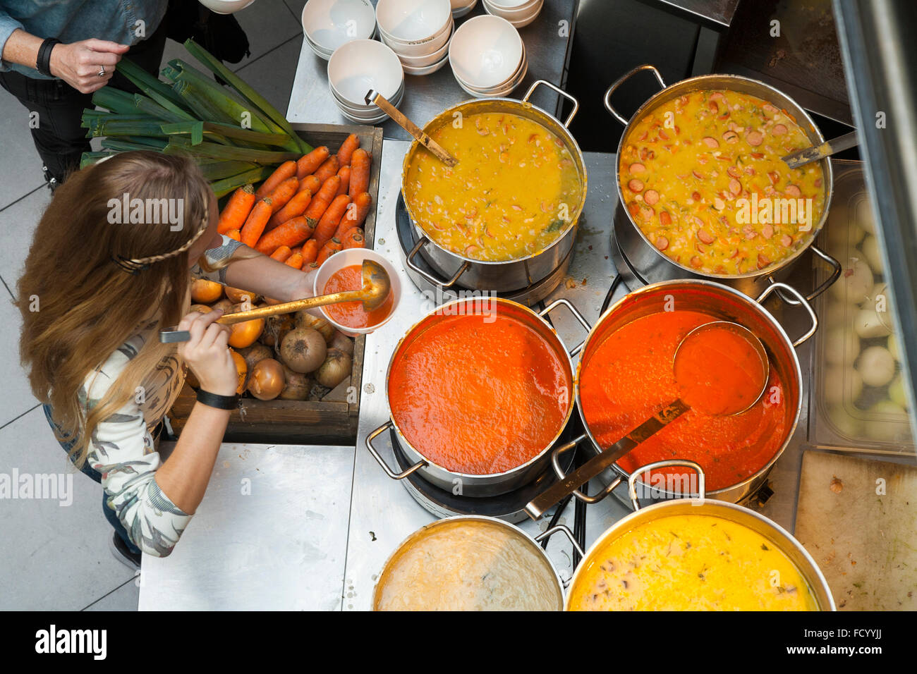 Customers serve themselves with hot soup at La Place self service food restaurant in central Amsterdam. Holland. - Stock Image