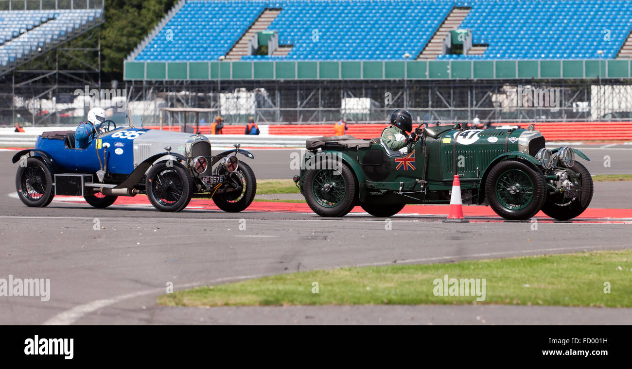 A Blower Bentley and a Vauxhall 23/60 Wensum competing in the  Kidston Trophy for Pre War Sports Cars at the Silverstone - Stock Image