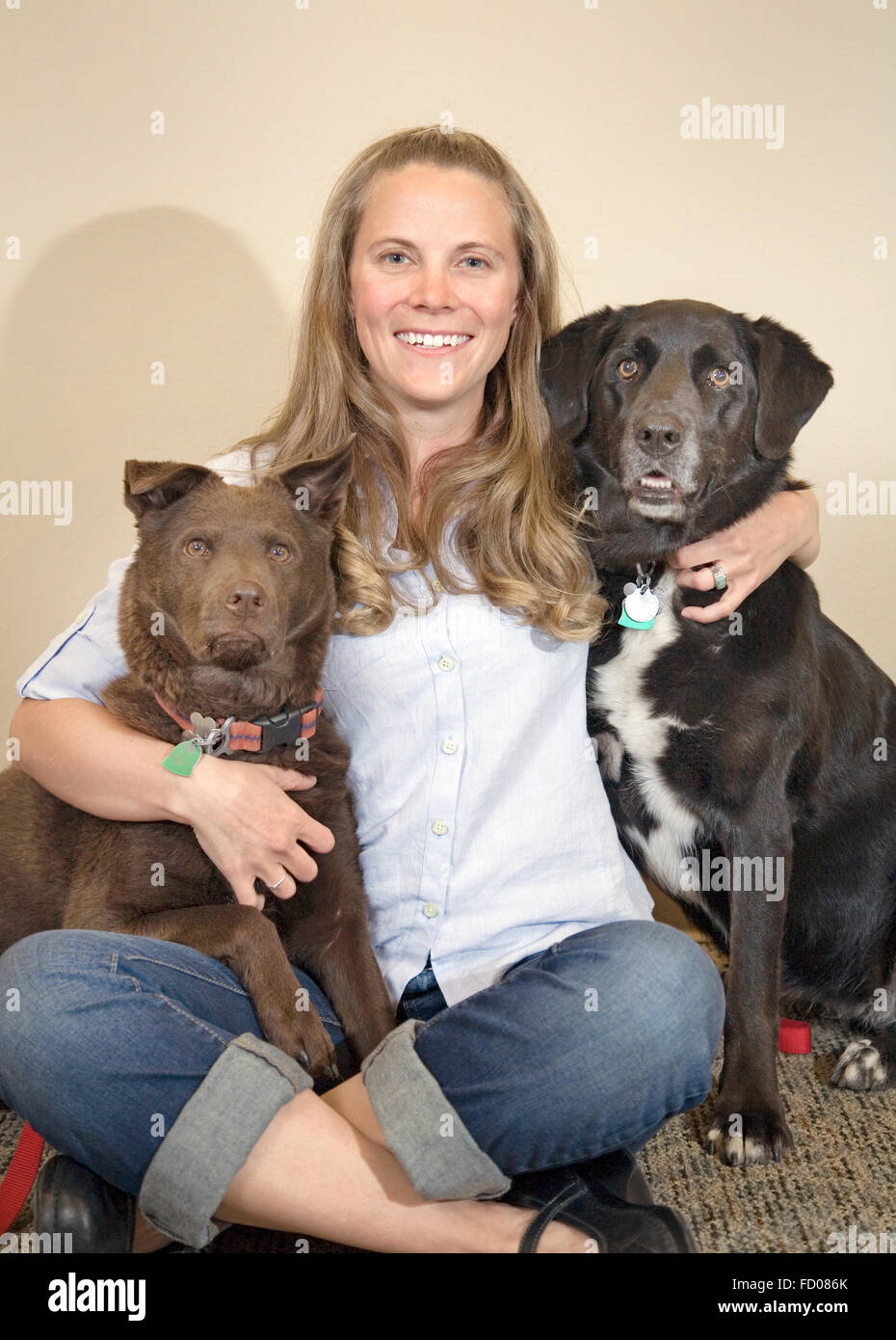 A woman with her two dogs - Stock Image
