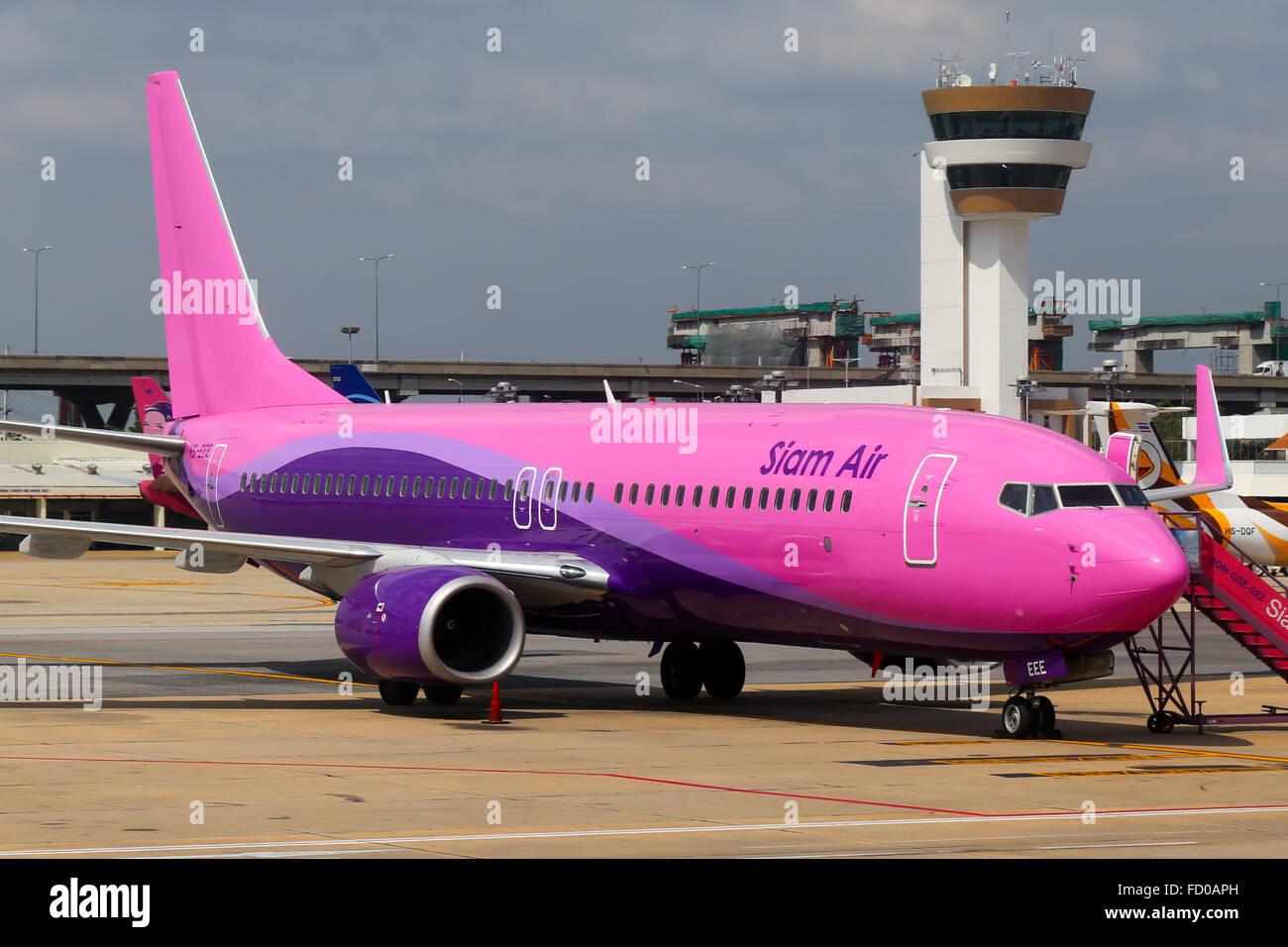 Siam Air Boeing 737-800 parked at Bangkok Bangkok Don Muang airport. - Stock Image