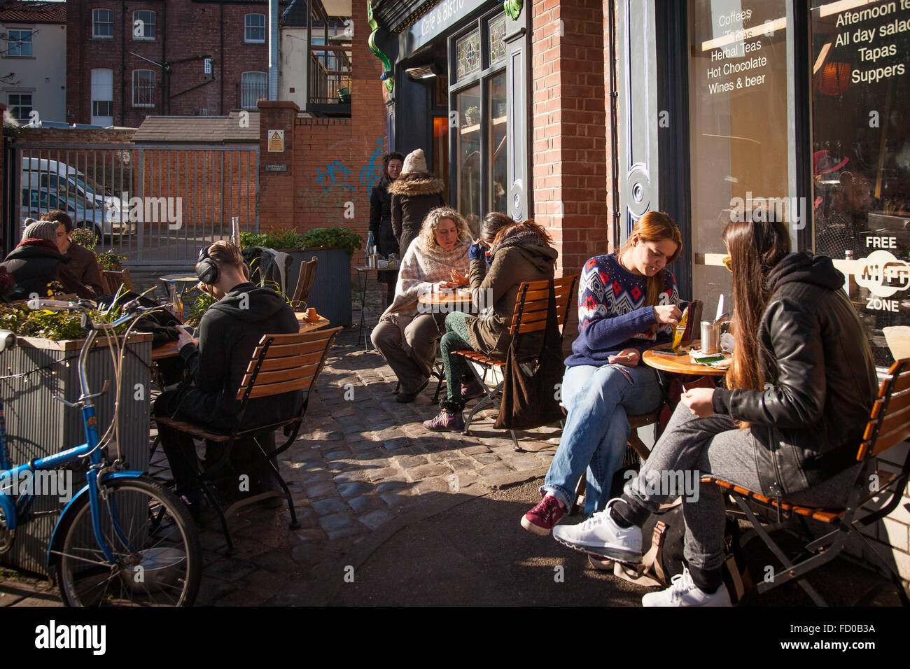 Trendy young people dining alfresco/ outdoors in Stokes Croft, Bristol, England - Stock Image