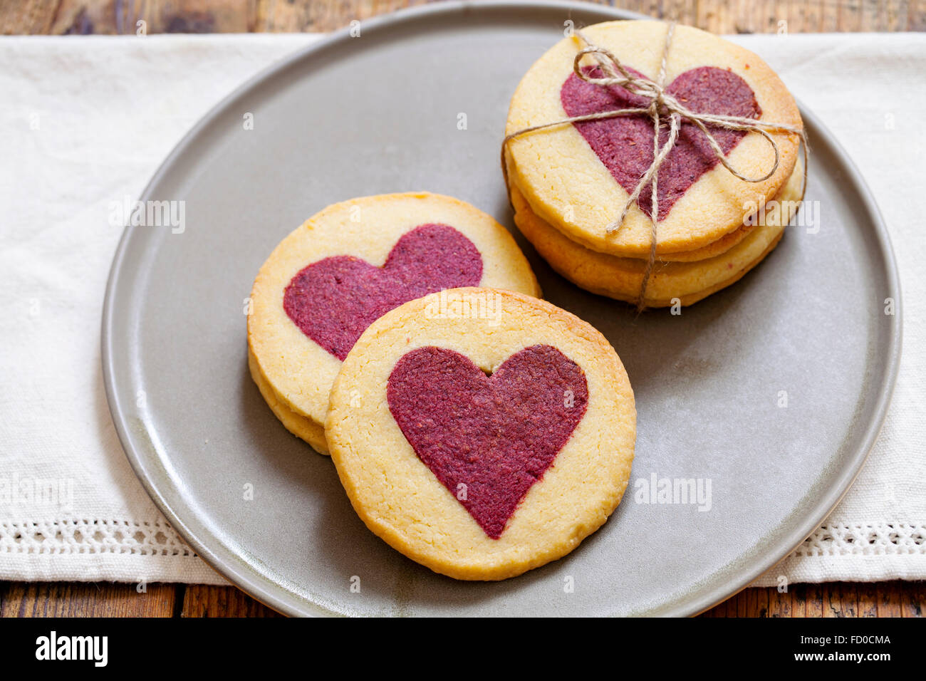 Valentine biscuits with raspberry hearts - Stock Image