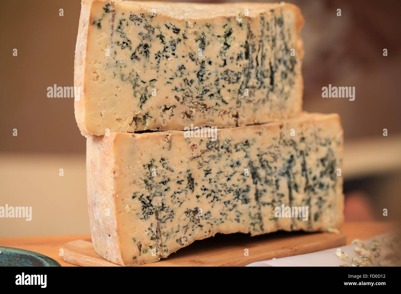 Sliced Gorgonzola or Roquefort cheese loaf - Stock Image
