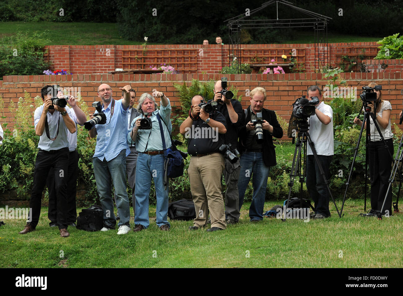 Photographers and TV crew filming lottery winnersUk Stock Photo