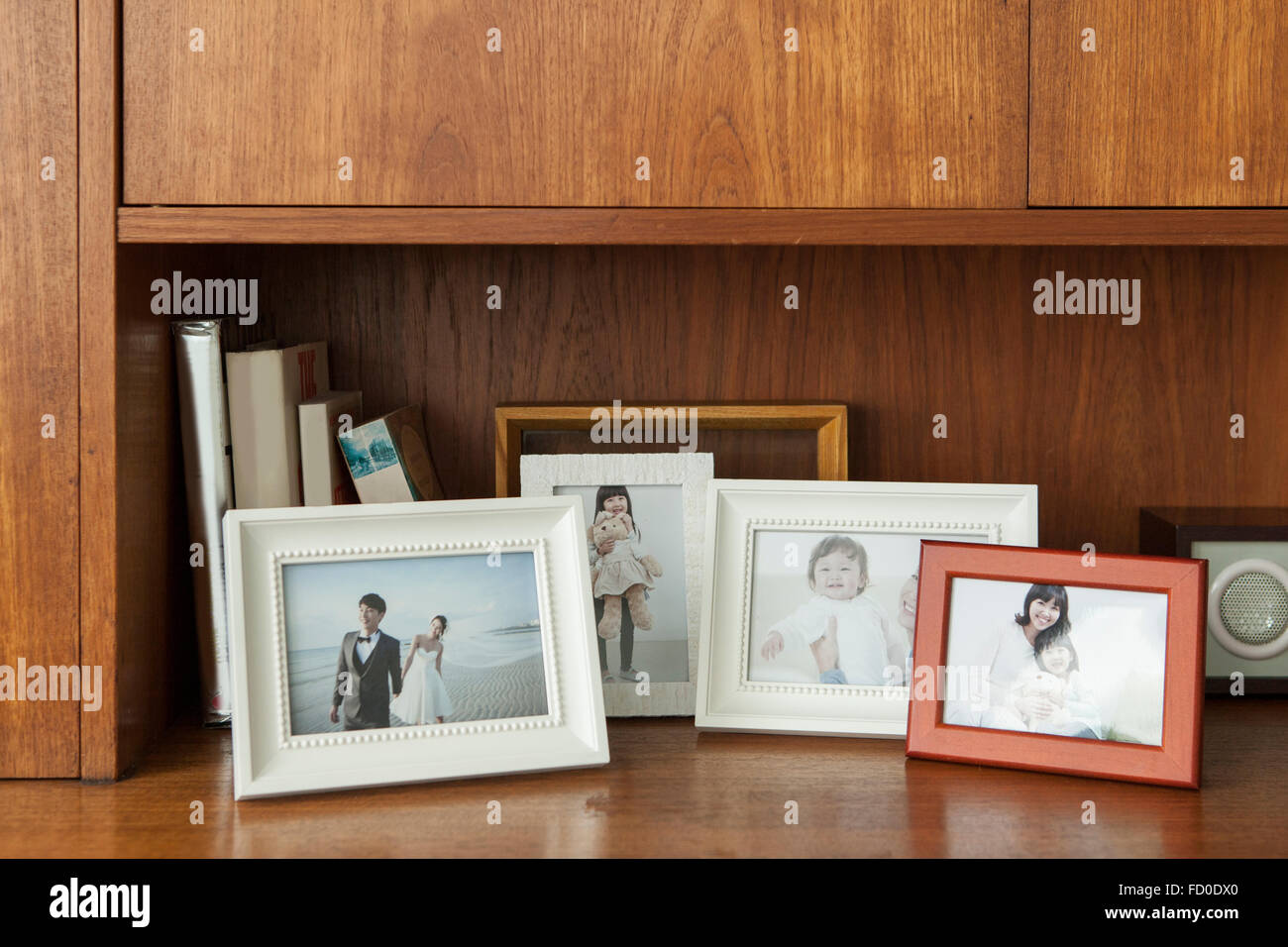 Family photos in frames placed together - Stock Image