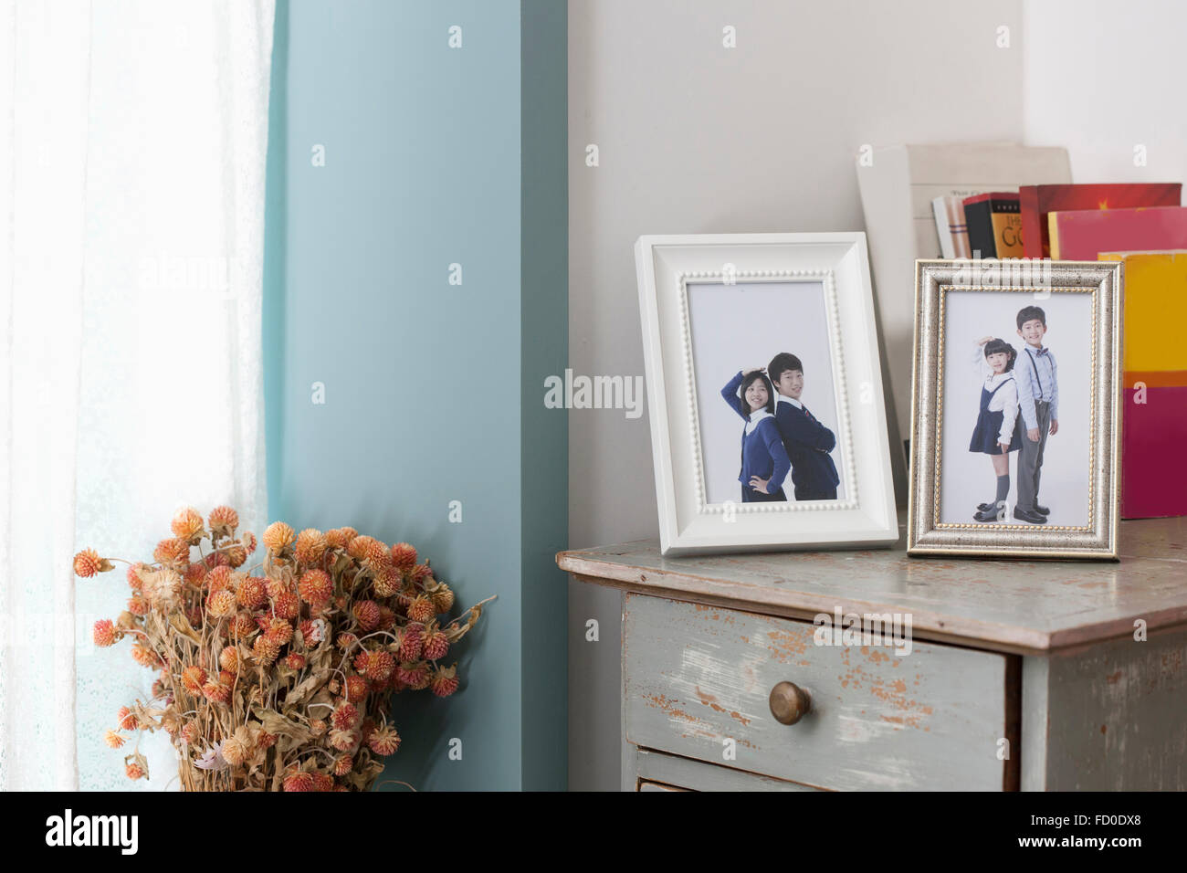 Children's photos in frames placed on a drawer - Stock Image