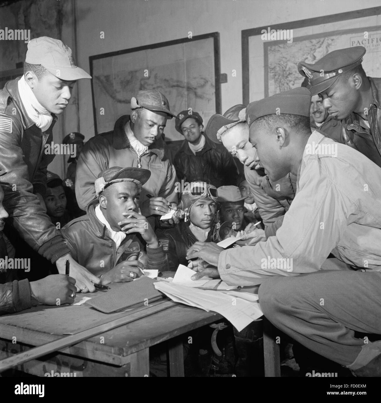 Tuskegee airmen from the 332nd Fighter Group receiving a briefing in Ramitelli, Italy in March 1945. - Stock Image