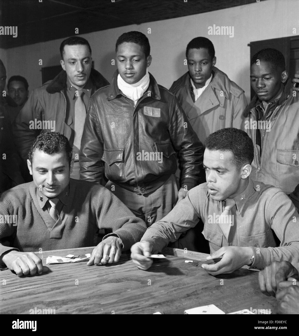 Tuskegee airmen from the 332nd Fighter Group playing cards in Ramitelli, Italy in March 1945. - Stock Image