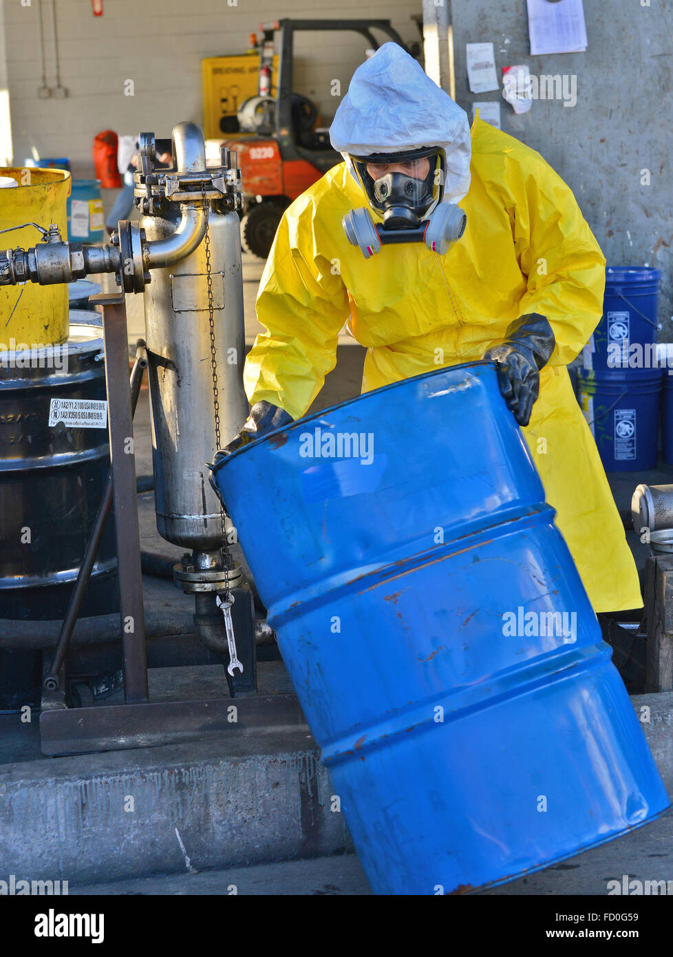 Hazardous containers disposal and handling - Stock Image