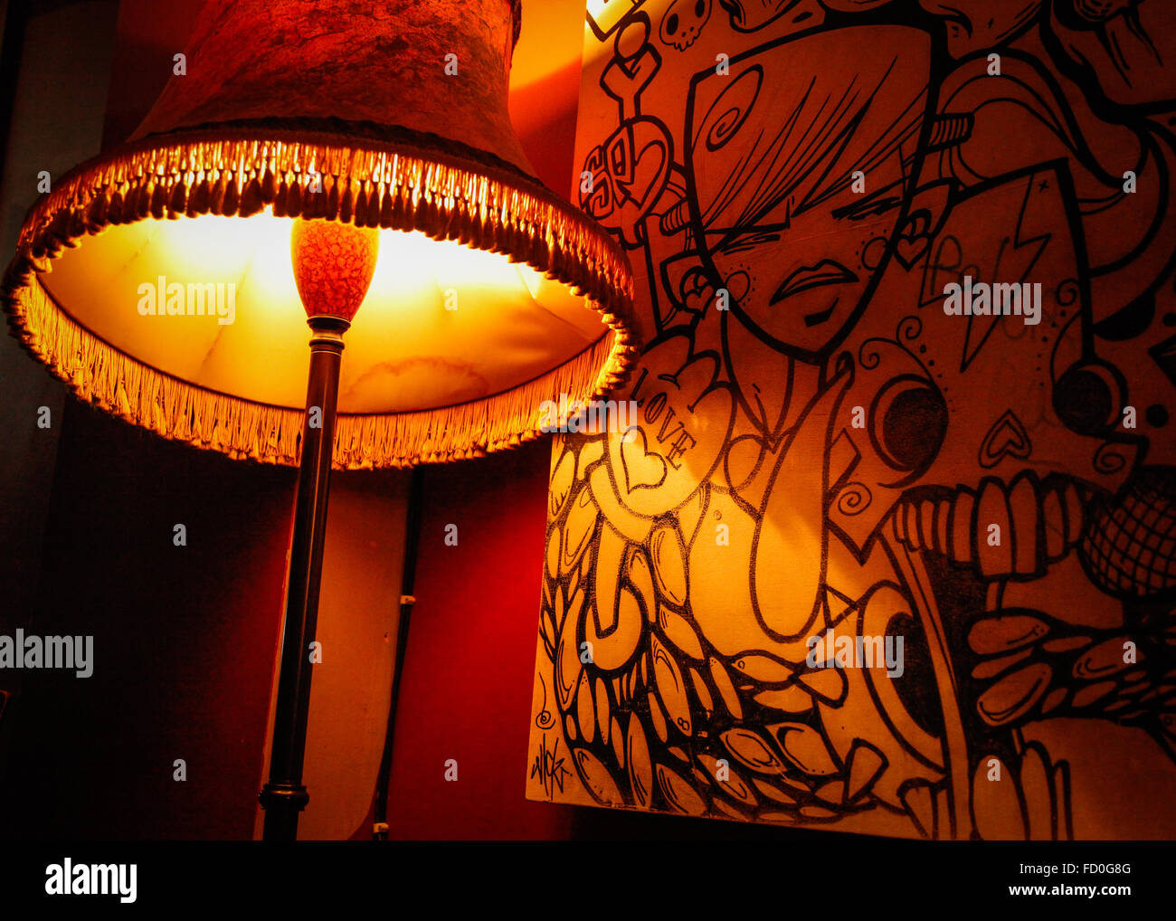 Warm cosy atmosphere + Love art in pub in Stokes Croft, Bristol, England - Stock Image