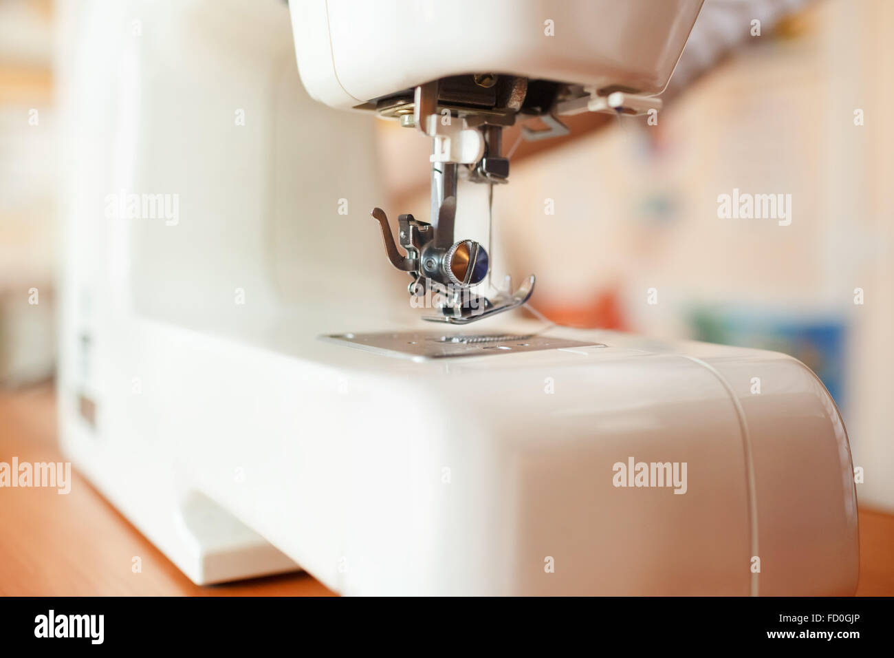Sewing machine needle working part, detail and accessories, modern white, perspective. - Stock Image
