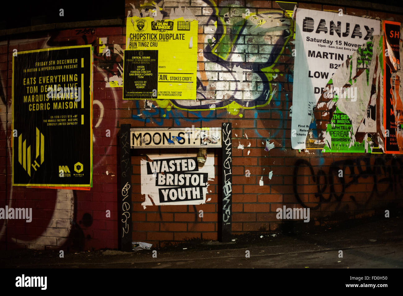 Music concert posters at night in Stokes Croft, Bristol, England - Stock Image
