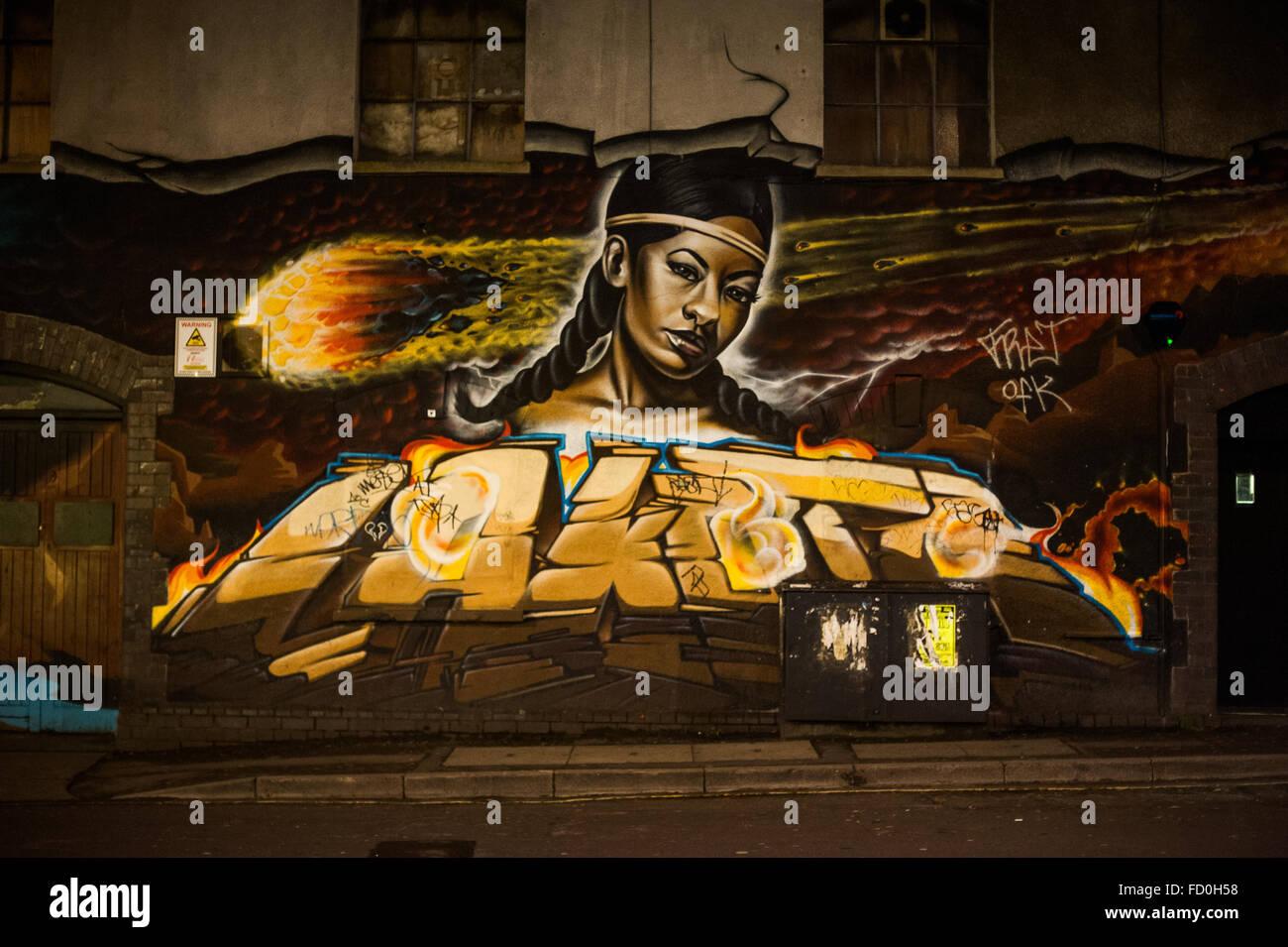 Urban street art at night in Stokes Croft, Bristol, England - Stock Image