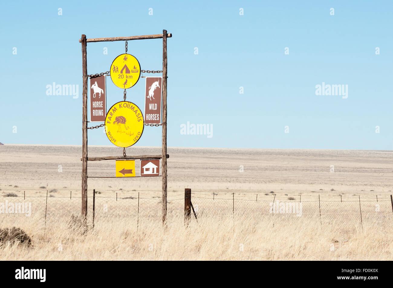 KOIIMASIS, NAMIBIA - JUNE 24, 2012: Sign post in the barren semi-desert area bordering the D707 road between Sesriem - Stock Image