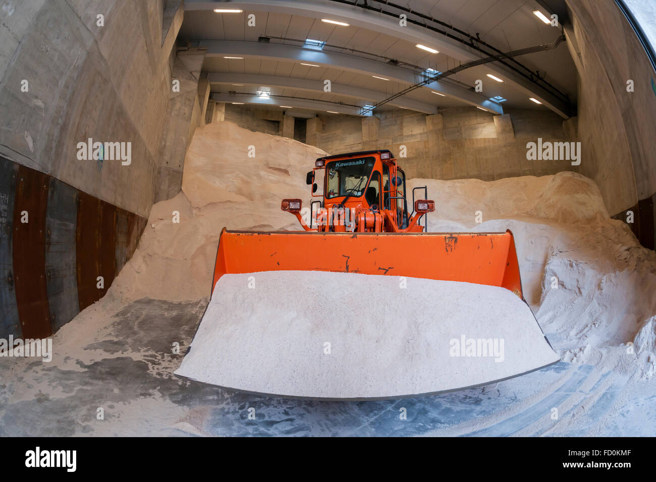 Piles of salt and equipment await this weekends winter snowstorm at the New York City Dept. of Sanitation Salt Shed - Stock Image