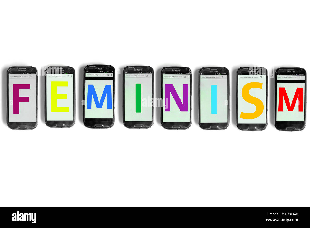 Feminism on the screens of smartphones photographed against a white background. - Stock Image