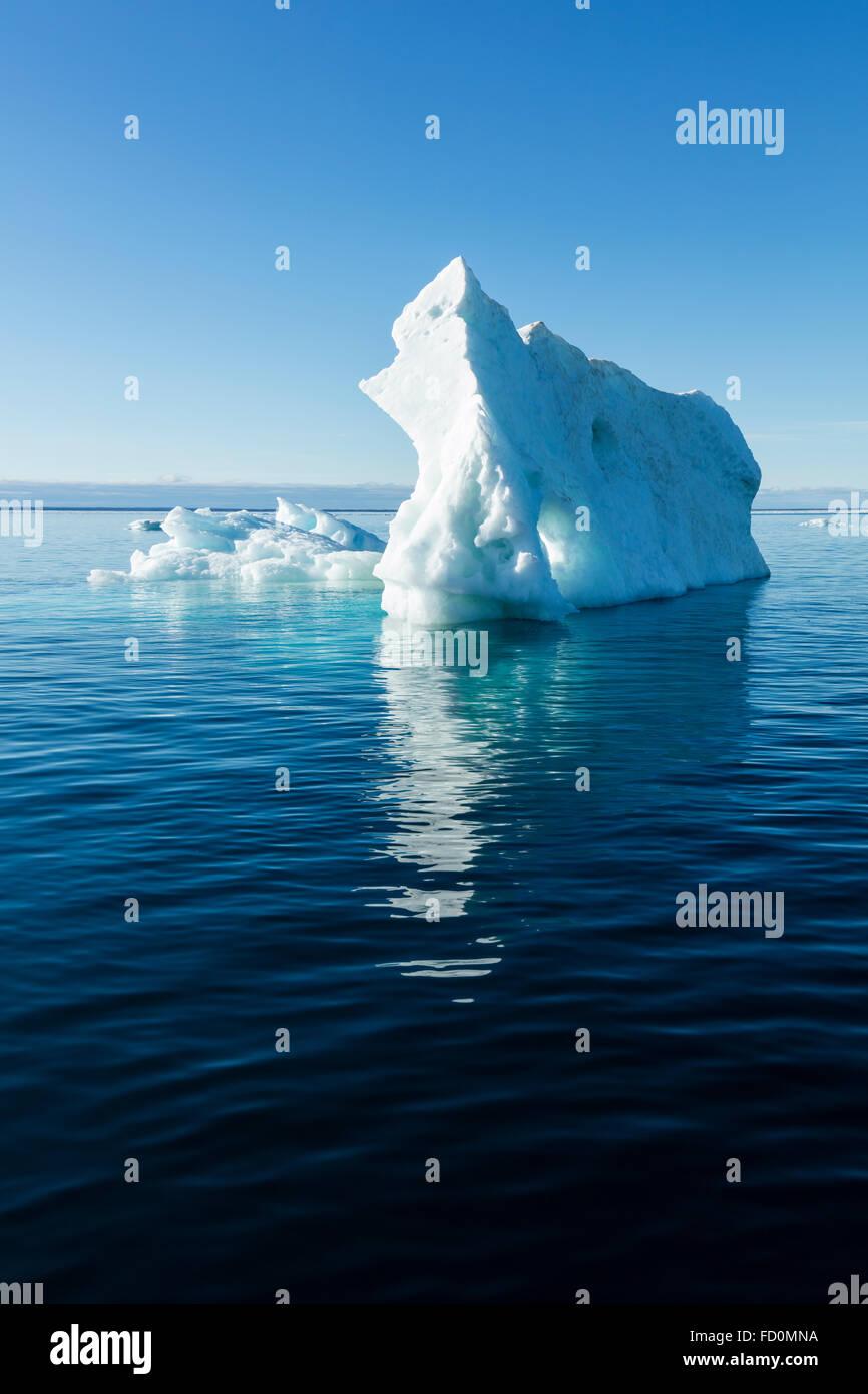 Canada, Nunavut Territory, Ukkusiksalik National Park, Melting iceberg floating in Hudson Bay on summer morning Stock Photo