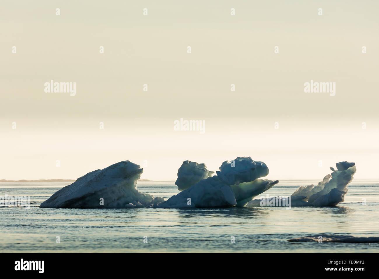 Canada, Nunavut Territory, Ukkusiksalik National Park, Melting iceberg floating in Hudson Bay on summer evening - Stock Image