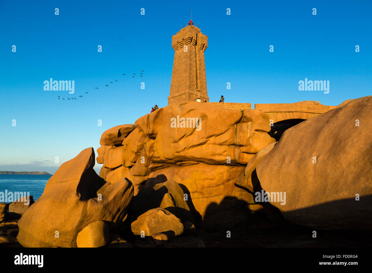 France,Brittany,Cotes d'Armor, the Men Ruz  lighthouse  at Ploumanach, commune of Perros Guirec Stock Photo