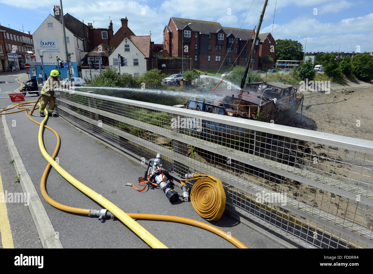 Boat fire dosed by fire service, Newhaven, UK - Stock Image