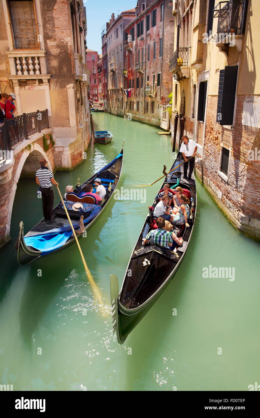 Venice - Gondola with tourists on the canal, Italy - Stock Image