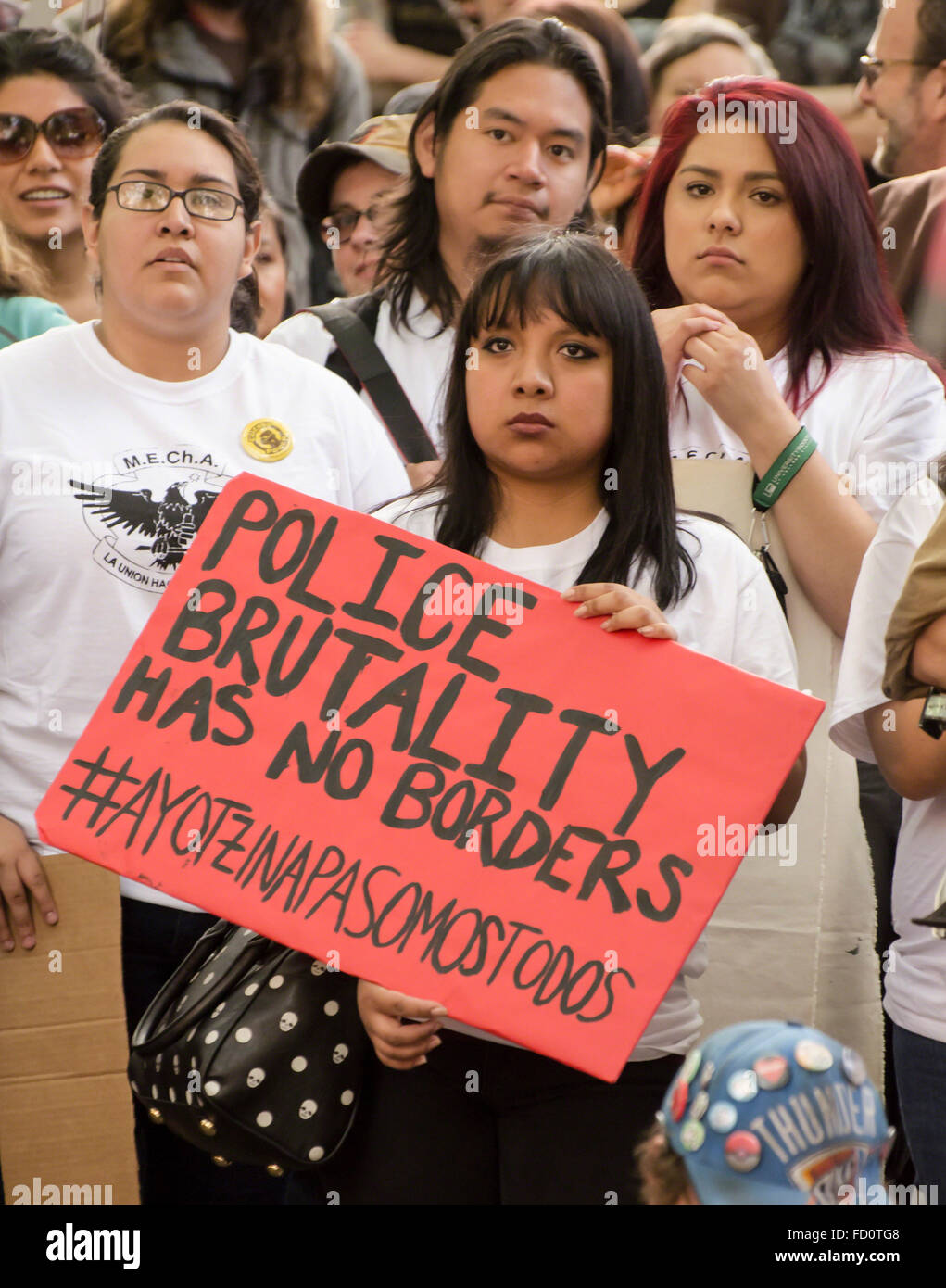 Young Hispanics hold sign that says Police Brutality Has No Borders during 2015 May Day Rally in Portland, Oregon. - Stock Image
