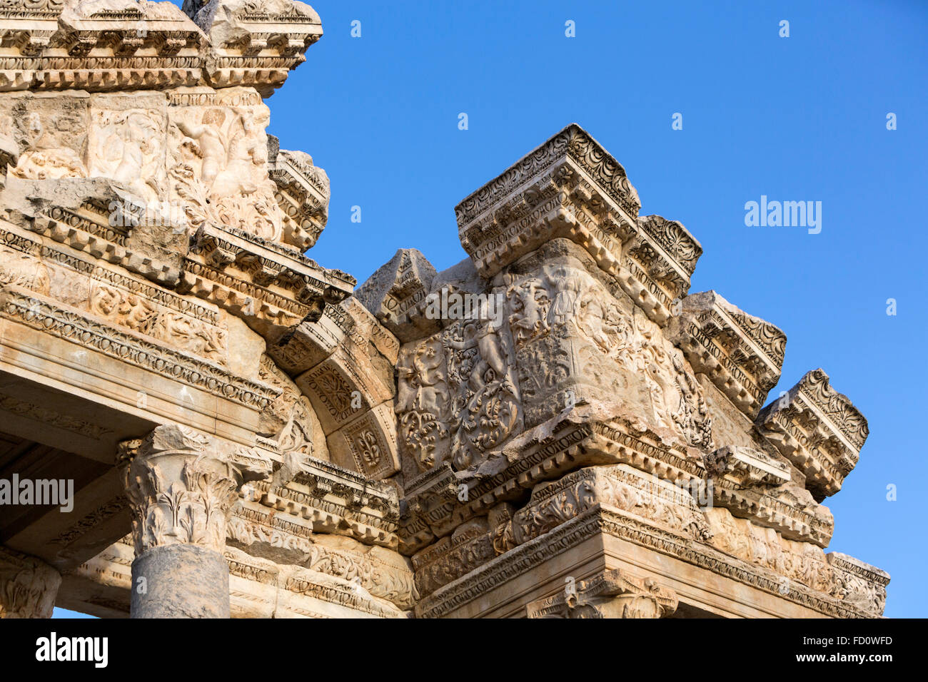 Western pediment of the monumental gateway or tetrapylon at sunset. Aphrodisias, Turkey - Stock Image