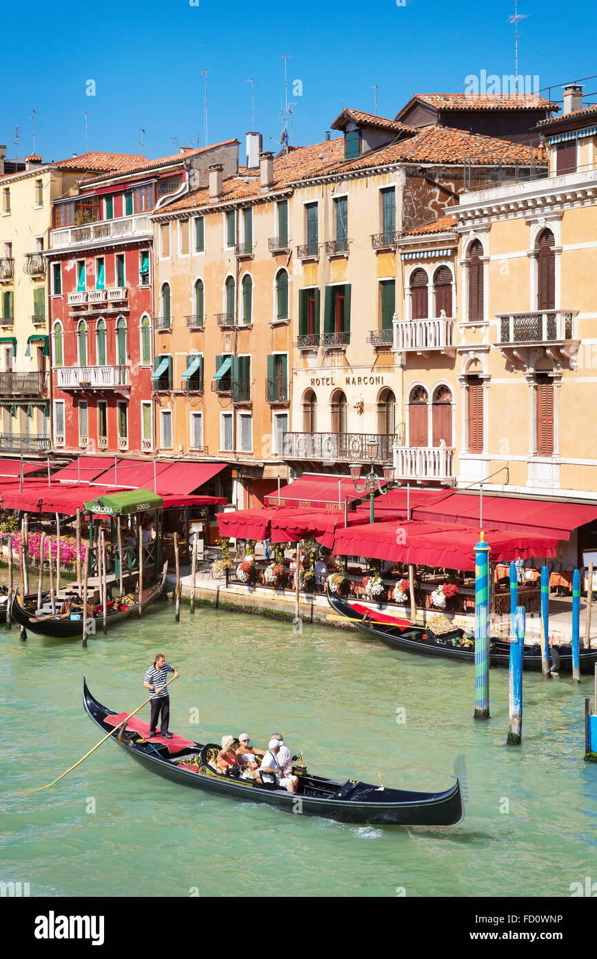 Venice - Gondola with tourists on Grand Canal, Italy, UNESCO Stock Photo
