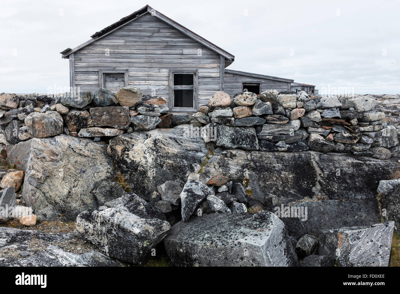 Canada, Nunavut Territory, Abandoned ruins of trading post along west coast of Hudson Bay at Fullerton Harbour - Stock Image