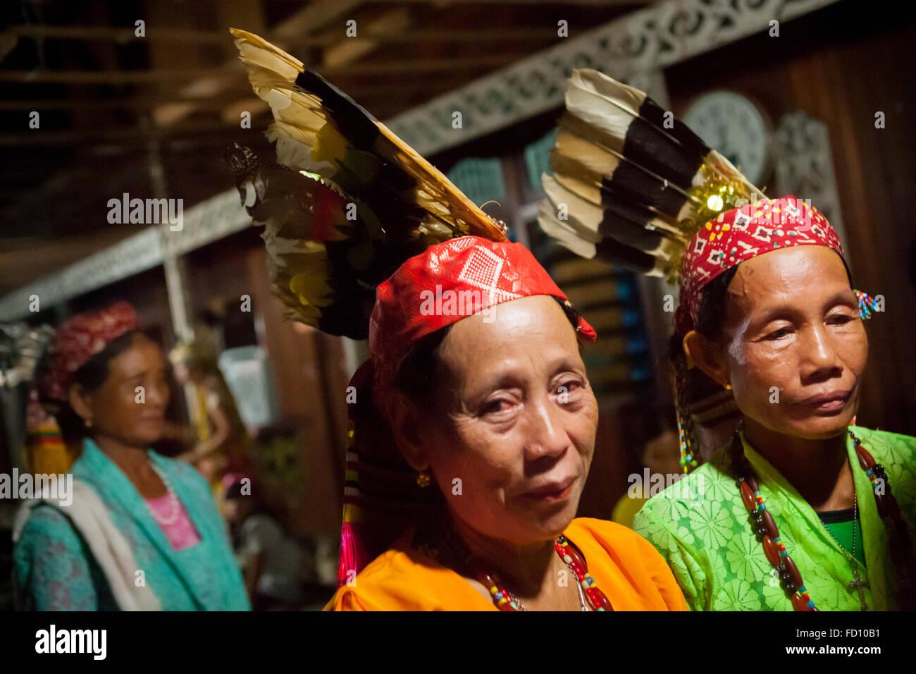Portrait of Dayaknese women of Taman sub-ethnic group inside Bali Gundi Longhouse in Putussibau, West Kalimantan, - Stock Image